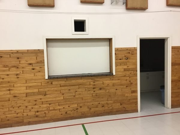 Original Plywood barricades at the Big Lake Hall kitchen
